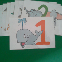 Plastic coated pages to help with numbers for pre-school children using animals.