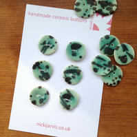 Turquoise splash buttons in stoneware