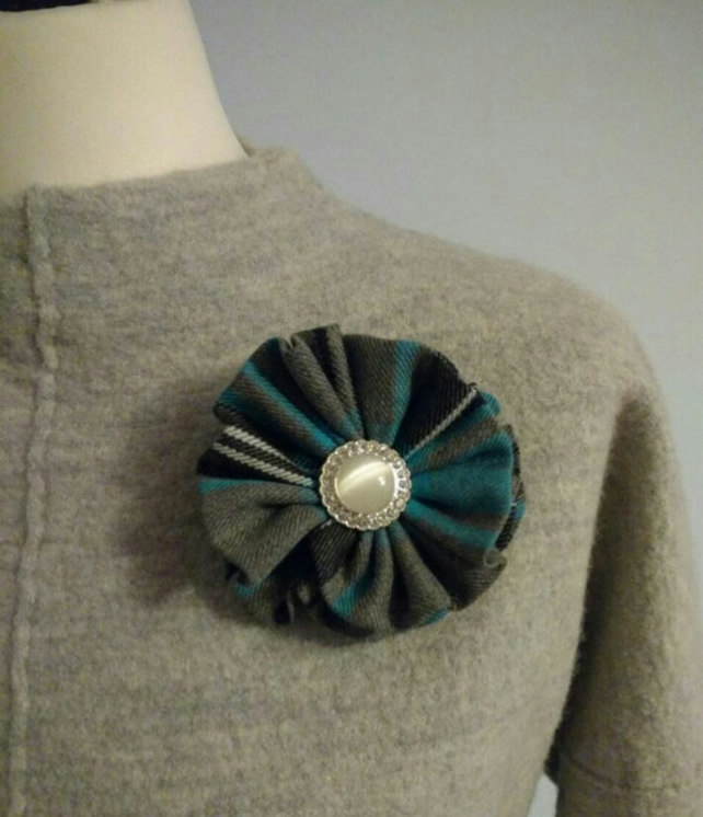 Blue tartan brooch with diamante centre