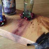 SOLD: Rip cut yew cheeseboard  with rose magenta  stripe and nibble-edge feature