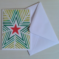 Starburst a handmade Christmas card of red and green stars and stripes