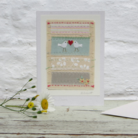 Hand-stitched card with doves and heart