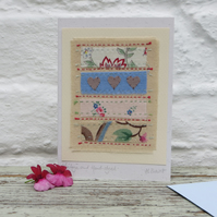 Vintage fabrics, hand-stitched card with applique hearts