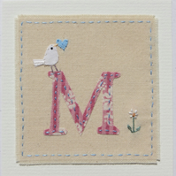 Hand-stitched letter M card with dove, heart and daisy flower