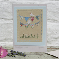 Hand-stitched mini bunting, little white doves, pretty card to keep!
