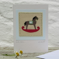 Hand-stitched rocking horse applique mounted on card - lots of detail, to frame?