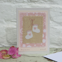Pretty hand-stitched baby bootees with hearts and bow - very sweet!