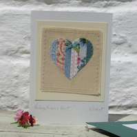Hand-stitched card, vintage fabrics patchwork with hand-tied silk ribbon bow