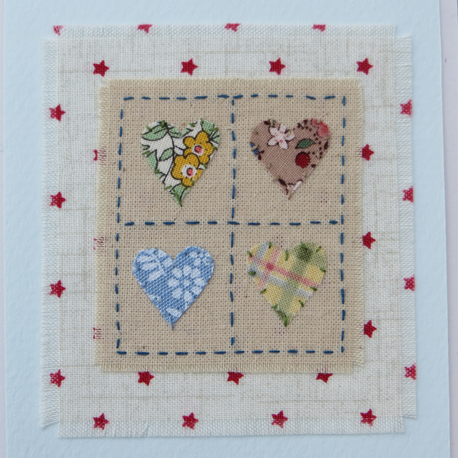 Happy Hearts card hand-stitched miniature textile on starry background