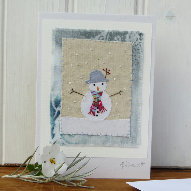 Sweet little snowman card with wintry background and berries in his hat!