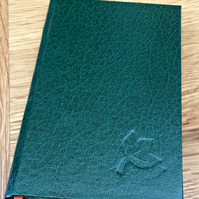 Green slim hardback blank notebook with debossed leaf on cover