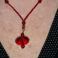 Single large faceted red acrylic pendant necklace