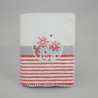 red and white needle book from recycled linen.