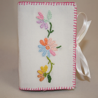 Needle book featuring bright daisies from recycled linen