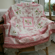 Patchwork throw from vintage embroidered linens.
