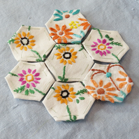 Bright hexagonal patches from vintage linens