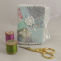 Needlebook from embellished vintage fabric scraps