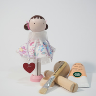 Miniature wooden clothespin doll