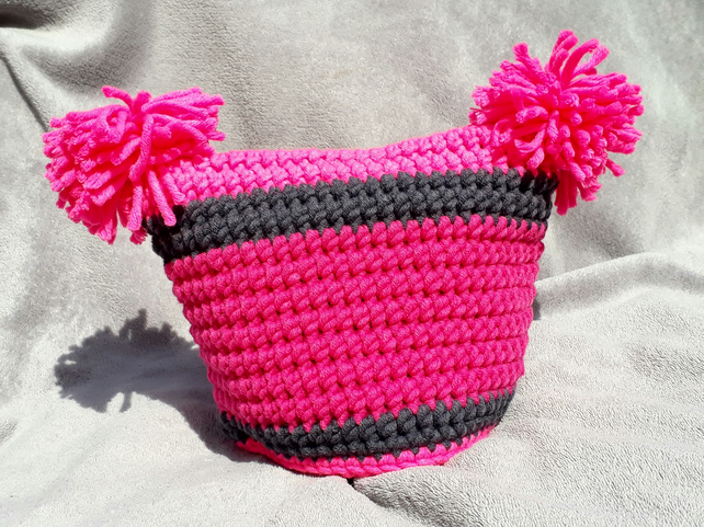 Unisex neon pink and grey ski hat with two pompoms