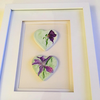 Handmade clay hearts, painted with watercolours.