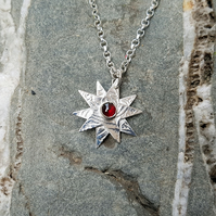Sterling Silver and Garnet Star Pendant