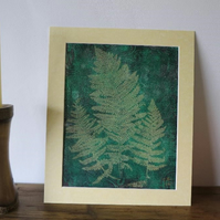 Fern mono-print on vintage swirls