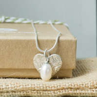 Silver Necklace with a Heart charm and Freshwater Pearl
