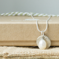 Silver Necklace with a Circle charm and Freshwater Pearl