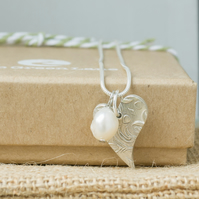 Silver Necklace with a Heart shaped Charm and unique Freshwater Pearl