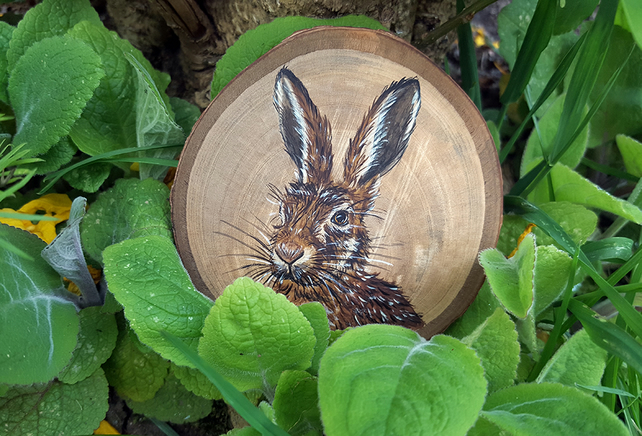 Original painting of a brown hare on a slice of cherry wood.
