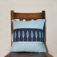 Screen-printed blue cushion with tree design