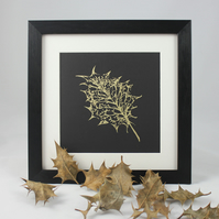 Screen-printed framed picture of holly leaf skeleton in gold ink