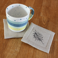 Set of four contemporary linen coasters, drinks mats
