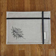 Set of four contemporary linen table mats, holly leaf design