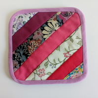Reversible Quilted coaster with stripe design in pinks and florals