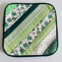 Reversible Quilted coaster with stripe design in greens and florals