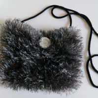 Black and Silver knitted crossbody bag, lined and with a long black cord handle