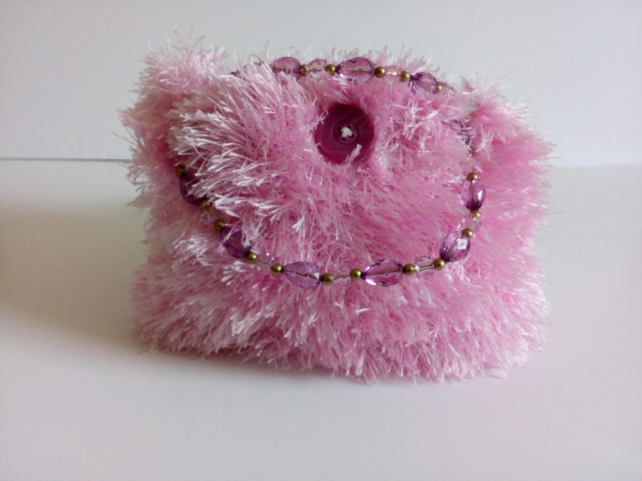 Pink knitted handbag, lined and with plastic bead handles, eyelash yarn