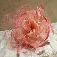 Stunning Coral Pink Flower and Sinamay Fascinator