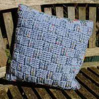 Crocheted pure merino wool cushion embroidered with French knots