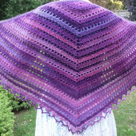 A super soft  purple and pink crocheted shawl edged with gold beads