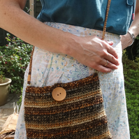 Brown, orange, beige striped crocheted shoulder bag with dotty cotton lining
