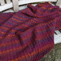 Autumnal coloured crocheted baby blanket in popular C2C design
