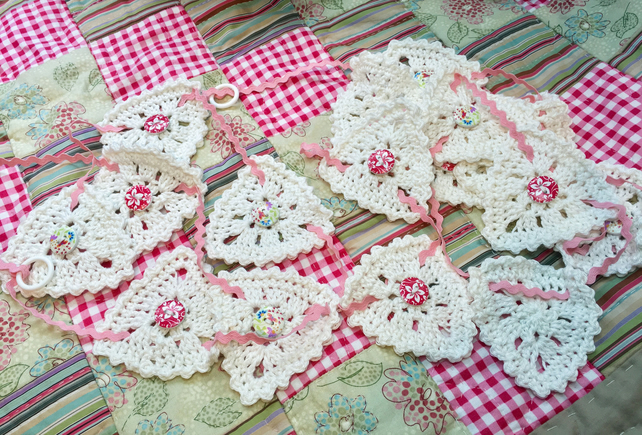 White cotton crocheted baby bunting with ricrac ribbon and wooden buttons