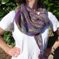 Knitted asymmetrical shawl or scarf in variegated wool yarn with tassels
