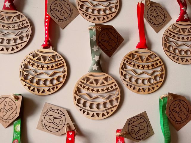Laser cut bauble ... with a choice of red ribbon designs