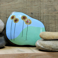 MP0407 - YELLOW FLOWERS on a green wave - Hand Painted Pebble - Paperweight.
