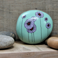 MP0406 - PURPLE FLOWERS on green - Hand Painted Pebble - Paperweight.