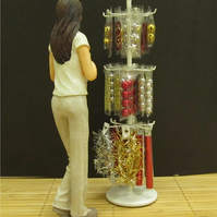 Dolls House 1:12th scale miniature shop display stand of Christmas decorations.