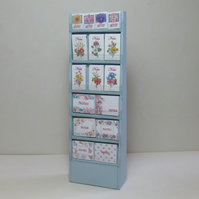 Dolls House shop miniature, freestanding notepad stand in Swedish blue